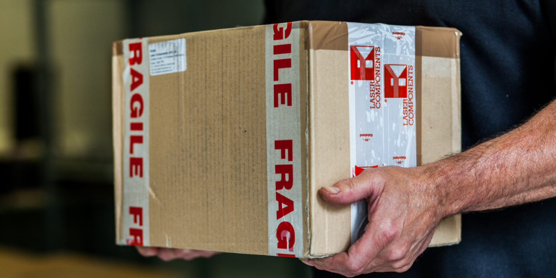 image of a person carrying a large box