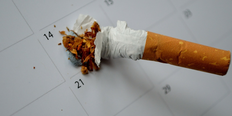 Image of cigarette being put out on a calendar