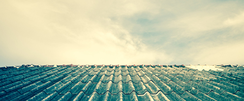 Roof tiles containing asbestos